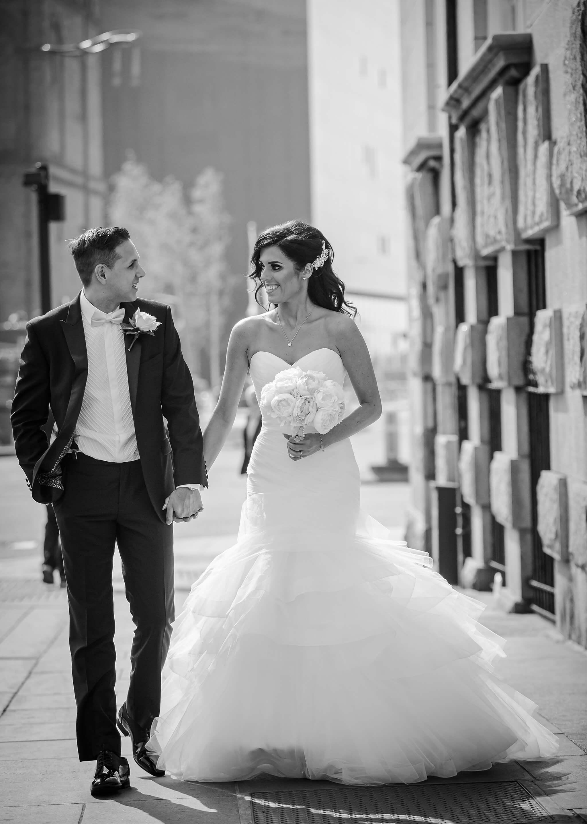 bride-groom-walking-30-james-street-liverpool-wedding-photograph