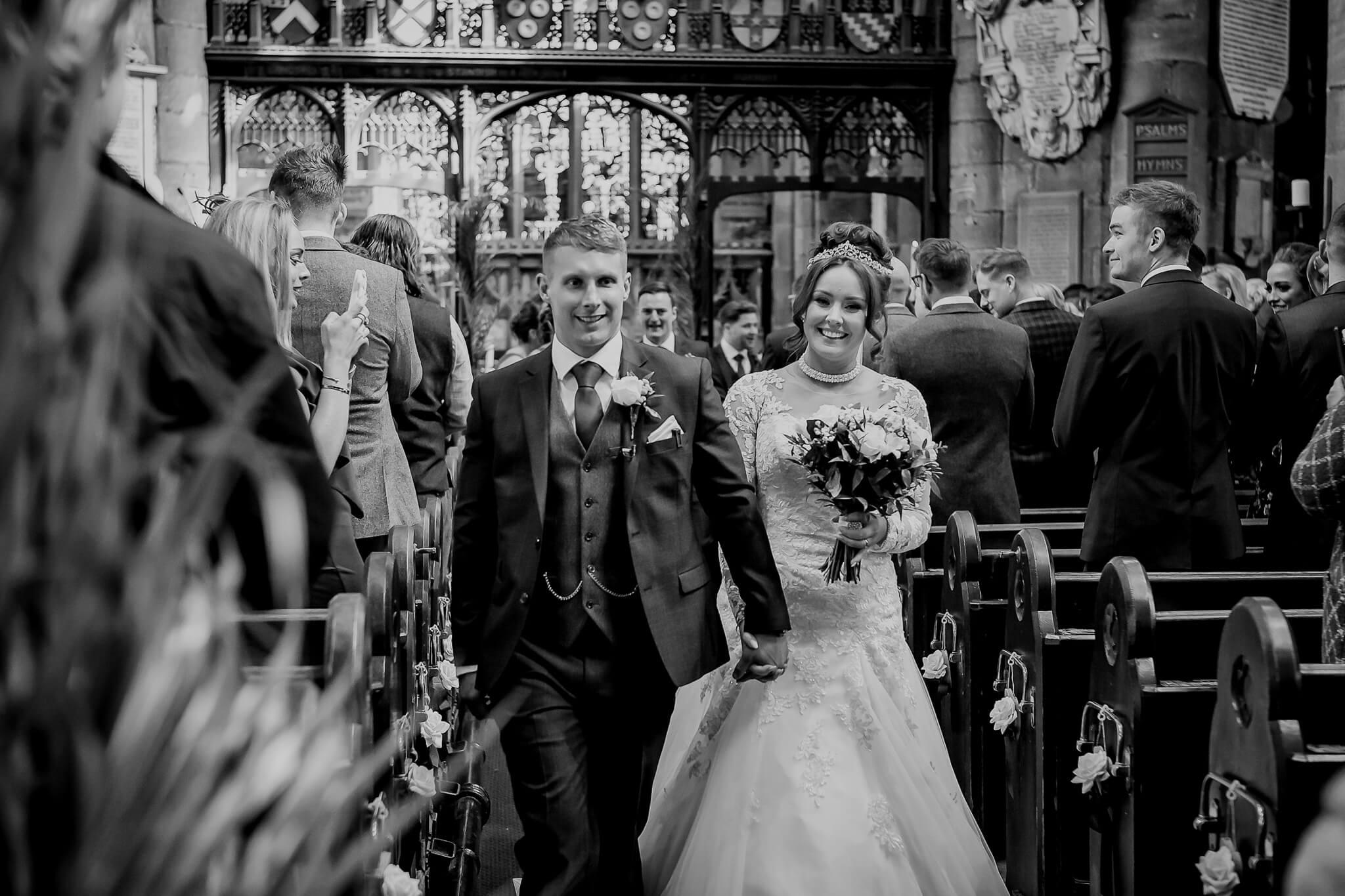 bride-groom-walk-down-aisle-stanbury-potography-wigan