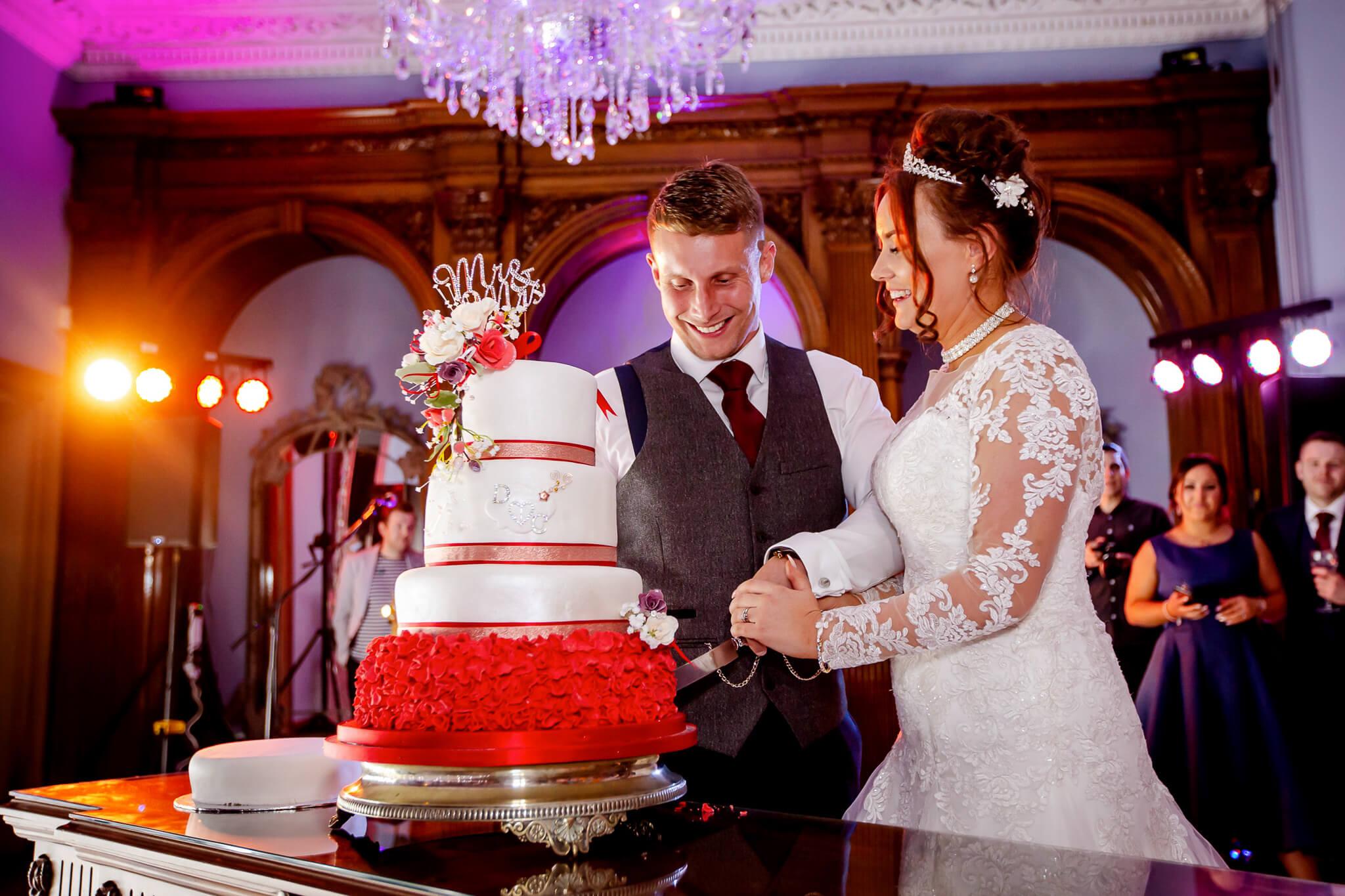 Haigh-hall-wigan-cutting-cake-stanbury-wedding-photography