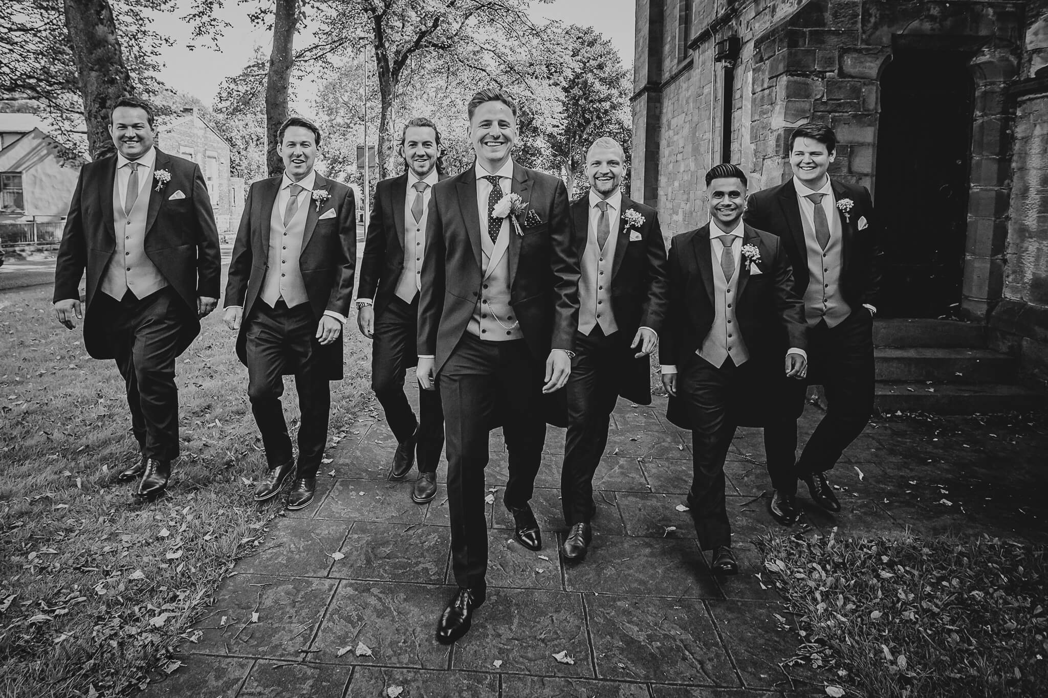 groomsmen-walk-owen-house-wedding-barn-photography-stanbury